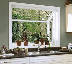 Another way to bring the outside in... a garden window. Herbs in the kitchen... oh yeah! I want to do this!!