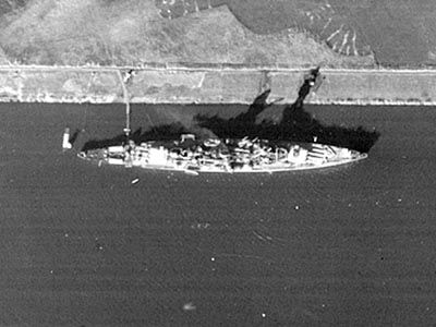German 'pocket battleship' Lutzow, date unknown, but her shadow indicates that she has a funnel cap and a platformed mast, thus during WW2 rather than prewar.  Despite her 11 in guns protection was not beyond heavy cruiser levels, and she was re designated as such in 1940: previously the 3 ships of the class were 'armoured ships'.