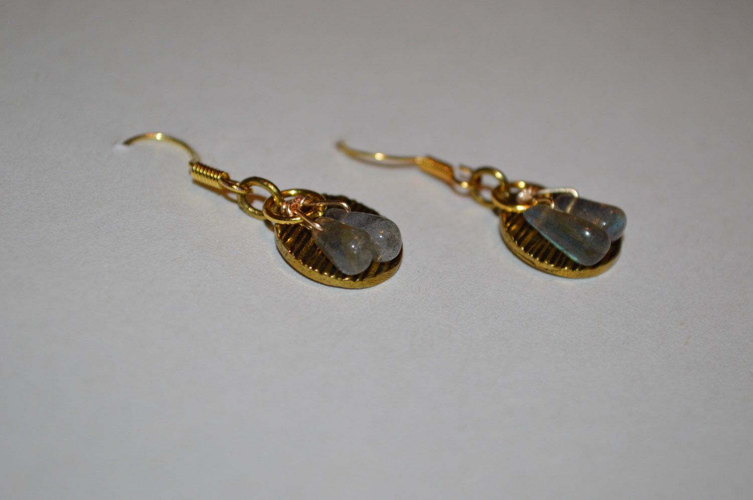 A personal favorite from my Etsy shop https://www.etsy.com/listing/473645775/labradorite-and-gold-earrings
