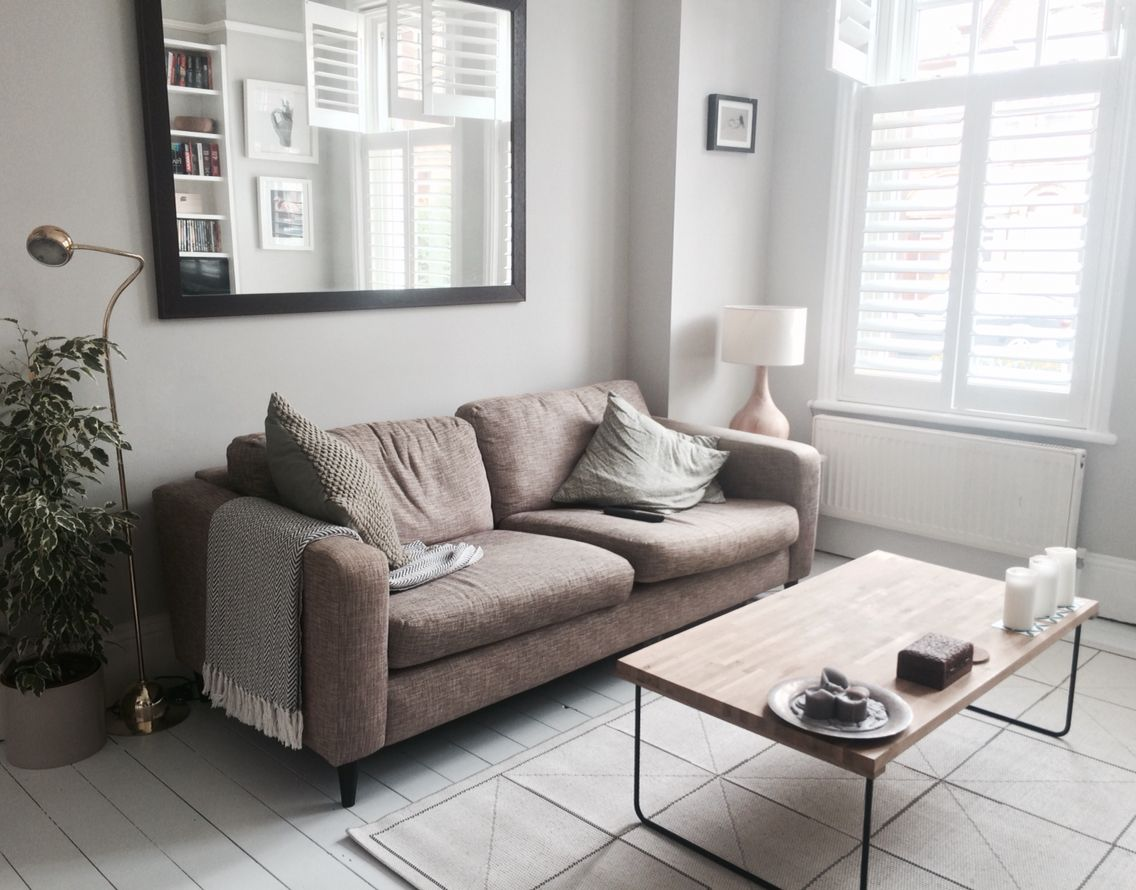 Living Room with grey walls white painted floorboards white