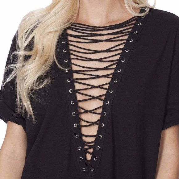 NWT Oversized Boyfriend Lace Up Tee Super cute oversized lace up boyfriend  tee by Emma   Sam (carried by LF). NWT and only worn to try on. 608fdeee5