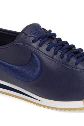 7fb0c741faf A NIKE CORTEZ SNEAKER This classic  70s running shoe is mostly waterproof.  (So