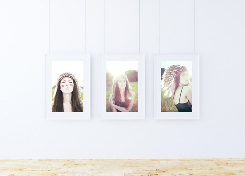 b283acb52ad This free mockup features 3 hanging picture frames against a white wall  with a wooden floor.