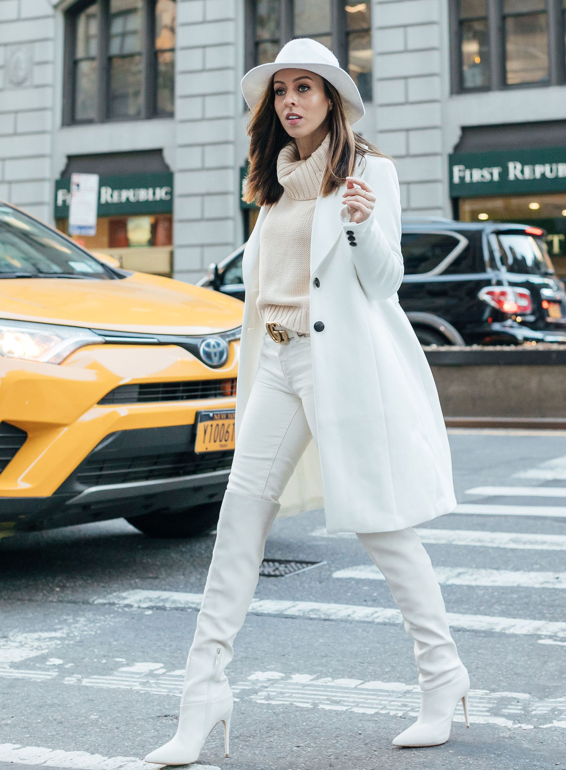 60ab44805c01 Sydne Style shows how to wear winter white in over the knee boots and jeans  #coats #white #boots #overthekneeboots #guccibelt @sydnesummer