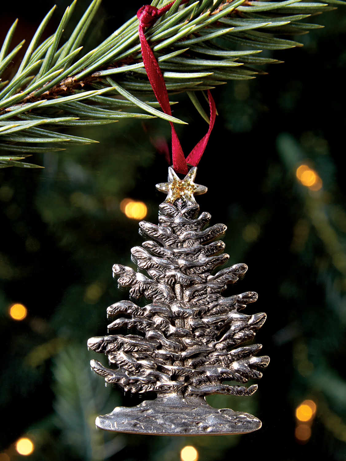 this snowy tree was handmade by a local artisan and reminds us of a classic christmas tree - Craftsman Christmas Classic