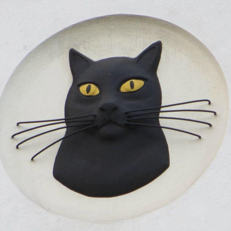 Black cat logo on the former Carreras cigarette factory in  Mornington Crescent.