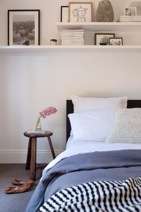 Chic Bedroom With White Shelving Over Bed Bedroom Features Black