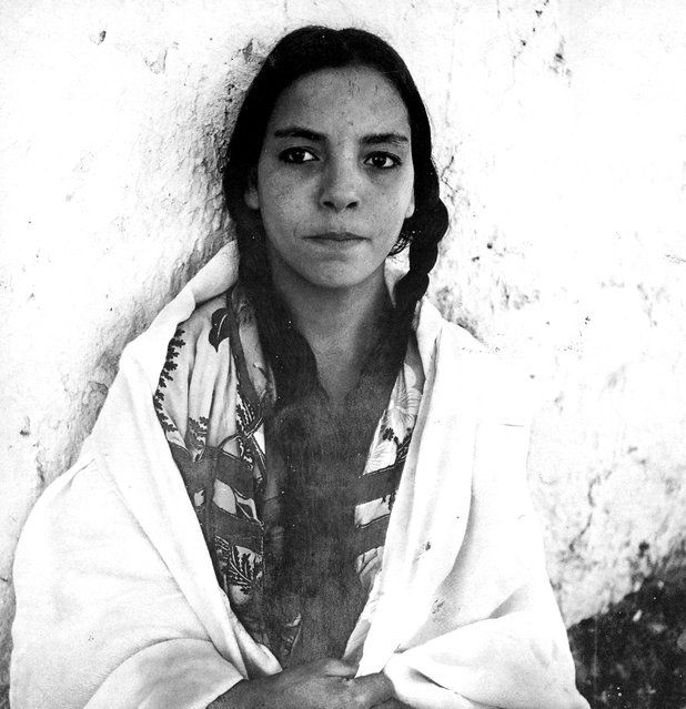 A 1960 photograph of an Algerian woman in a French regroupment village. (Photo by Marc Garanger) | photo | Pinterest | Women, Portrait and 1960s