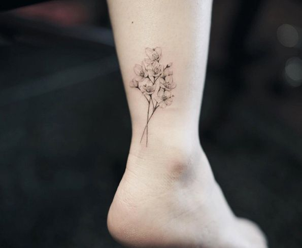 Colorless Cherry Blossom Tattoo On Ankle By Nando Back Tattoo Blossom Tattoo Cherry Blossom Tattoo