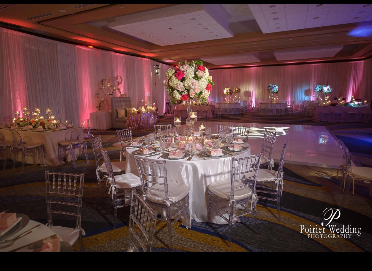 Royal wedding stage decoration  Event draping and bistro lighting decor at the Jupiter Beach Resort