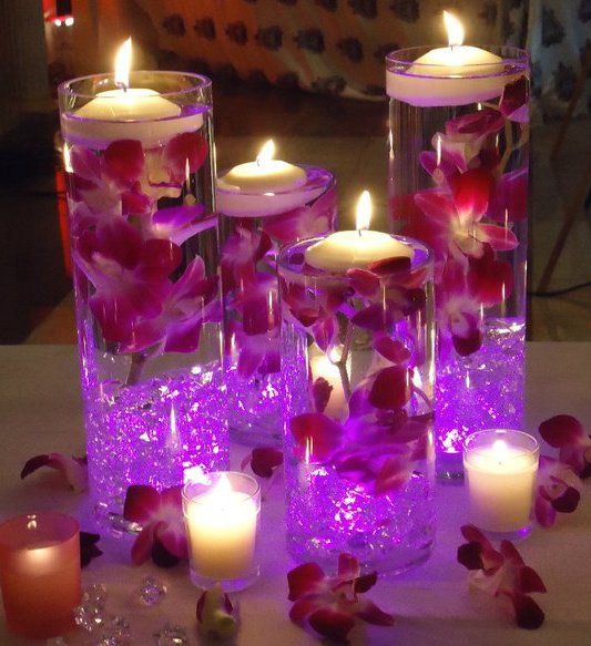 Centerpiece With Floating Flowers And Led Light Google Search Candle Wedding Centerpieces Floating Candles Wedding Candle Centerpieces