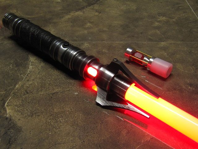 "Descent LED Sabers - Saber Forge - with the ""White LED"" option.   Instead of the blacks go with browns with a brown weathered look.  The look of the gray metal would still be there. The handle with be ether of a brown (not dark brown) hockey tape or suede."