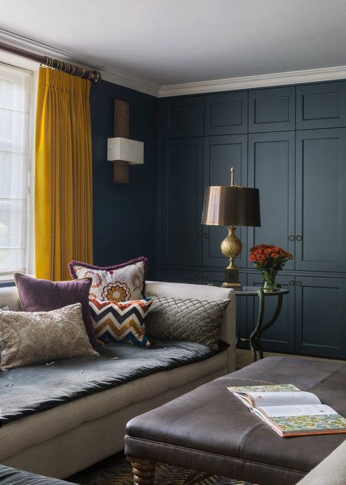 Dark Blue Panelling Contrasts With Mustard Yellow Curtains In A