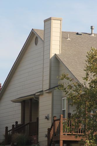 Your Home S Chimney Chase Is The Decorative And Protective Box Built Around The Chimney We Are Able To Repla House Exterior Exterior Siding Windows And Doors