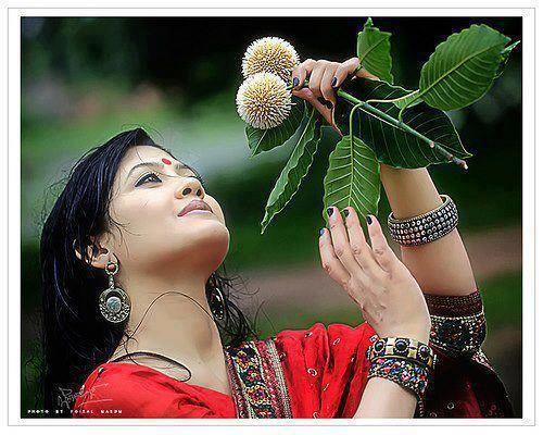 a beautiful girl with kodom flower
