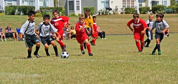 Chasing The Ball Soccer Boys Us Soccer Youth Soccer