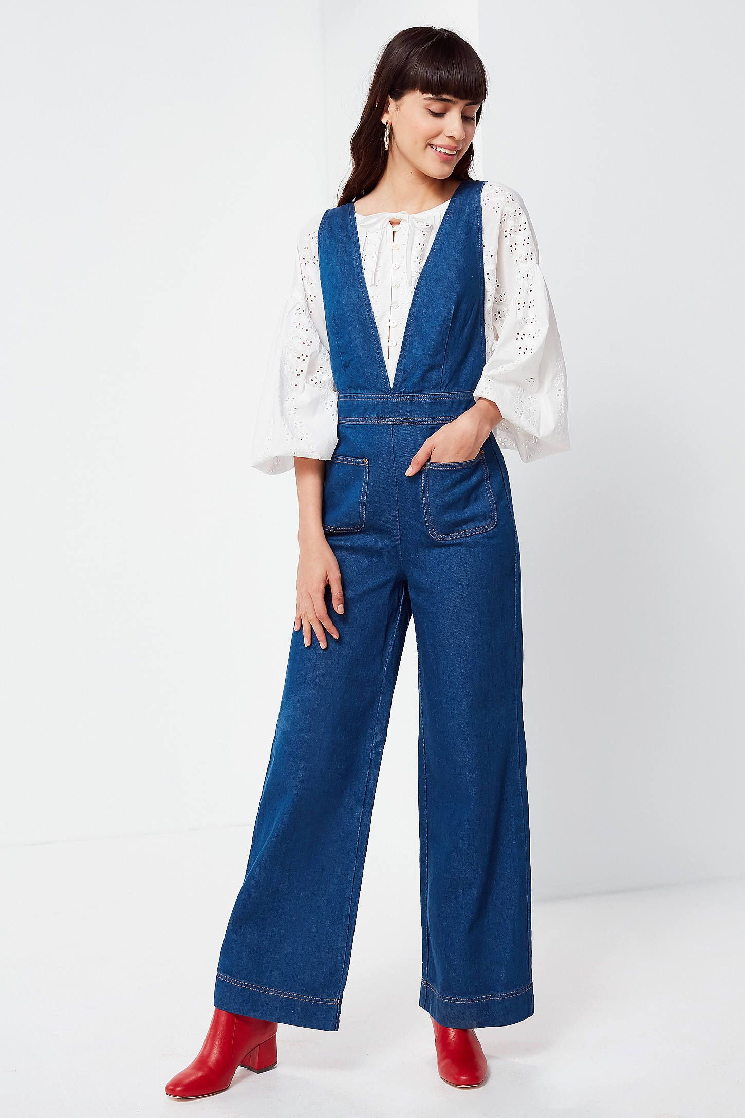 9a984bf7f64 Shop UO Eleanor Plunging Denim Jumpsuit at Urban Outfitters today. We carry  all the latest styles