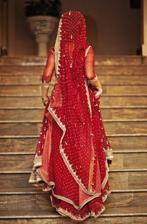 Best Indian Bride Running Up The Stairs In Her Red Wedding 400 x 300