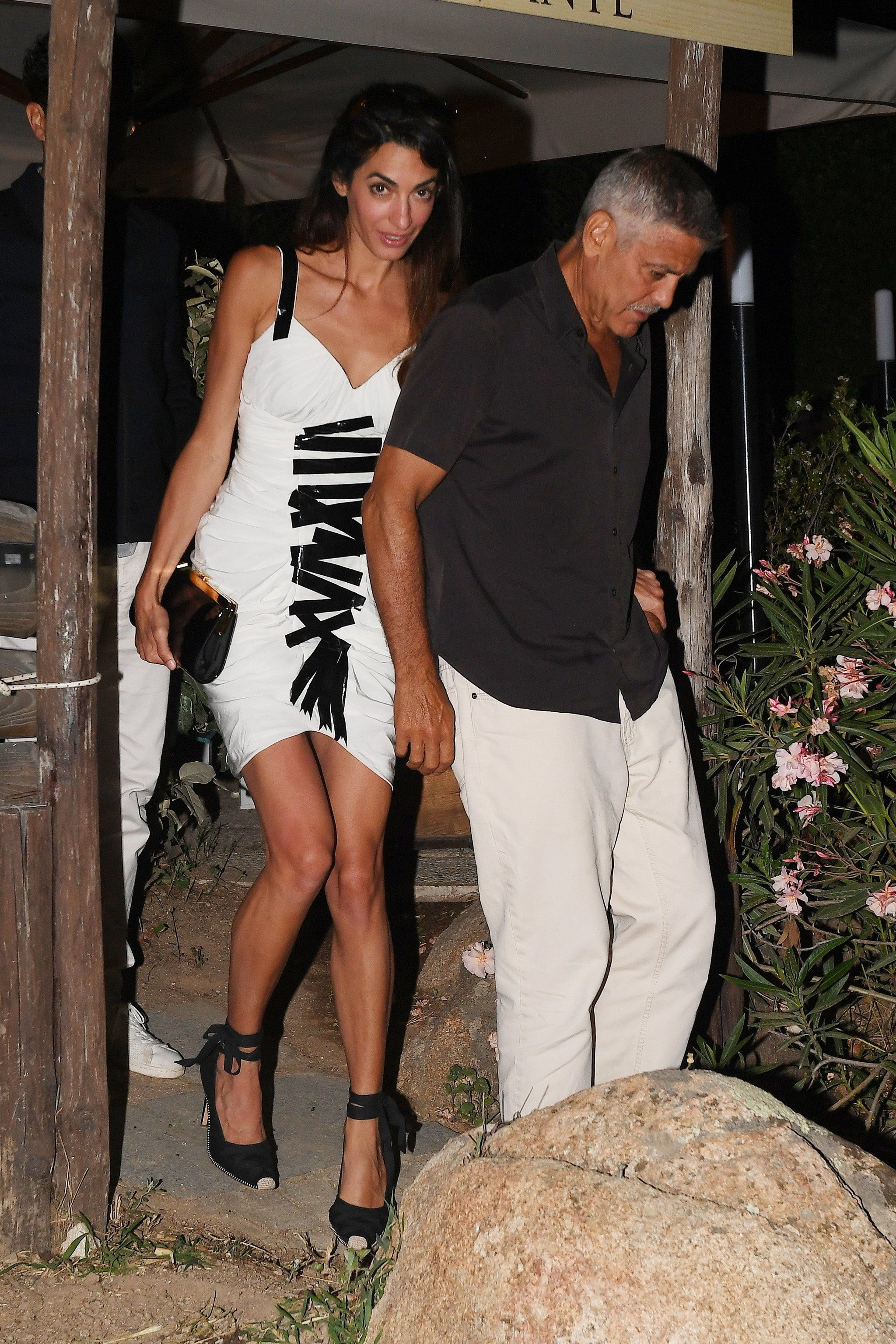 29853b562 Amal Clooney's Sexy White Minidress Looks Like It's Being Held Together by  Tape