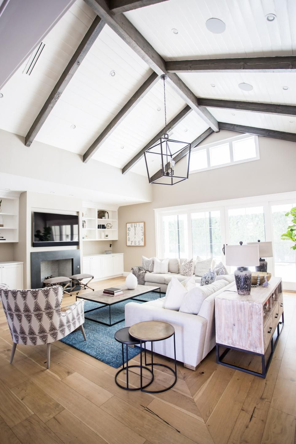Transitional Living Room Boasts Vaulted Ceilings With Wood Beams