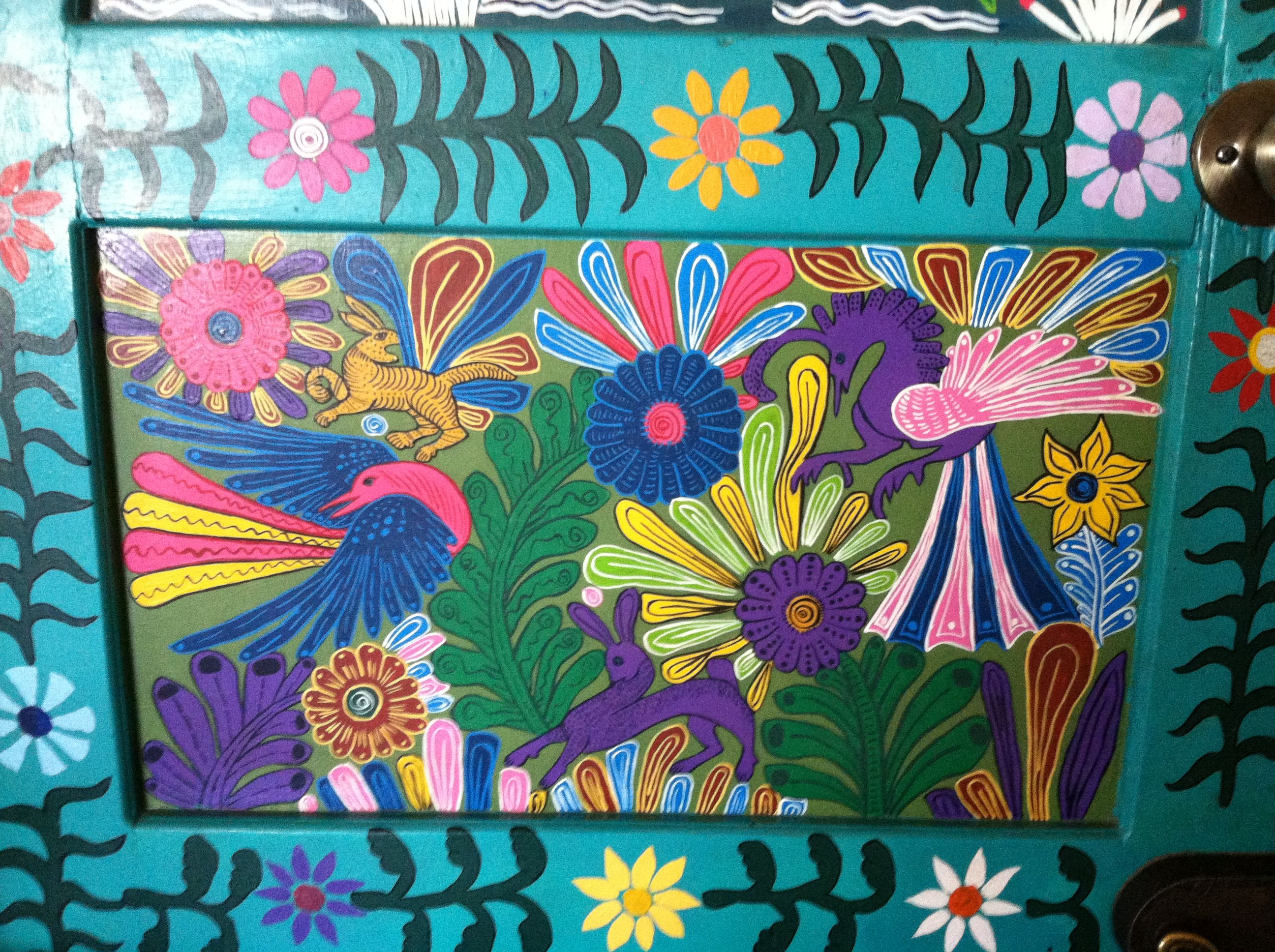 Door panels of entrance to Friendly Dauphin Restaurant in Mexico
