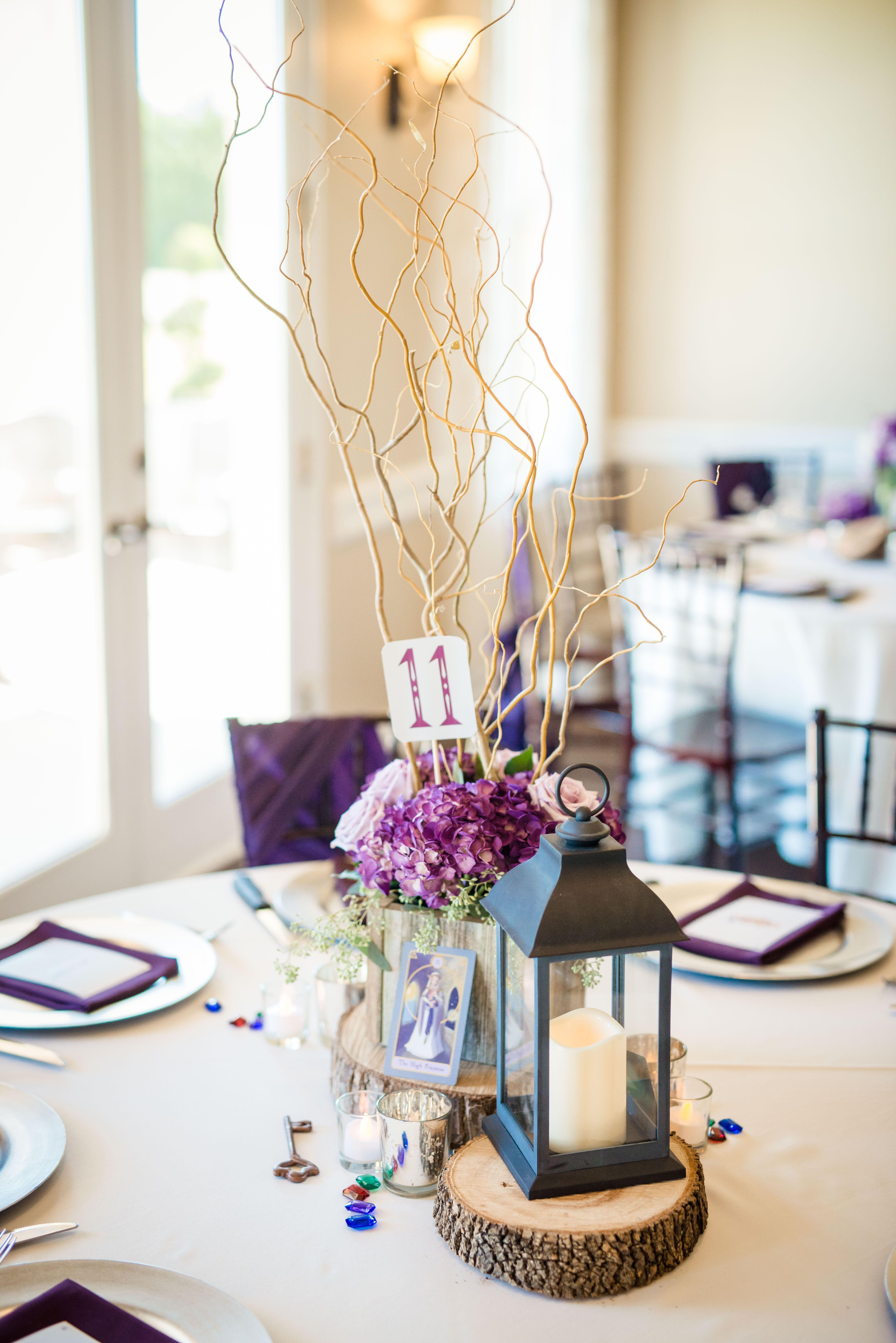 Reception table #11 included a lantern topped with flowers and a ...
