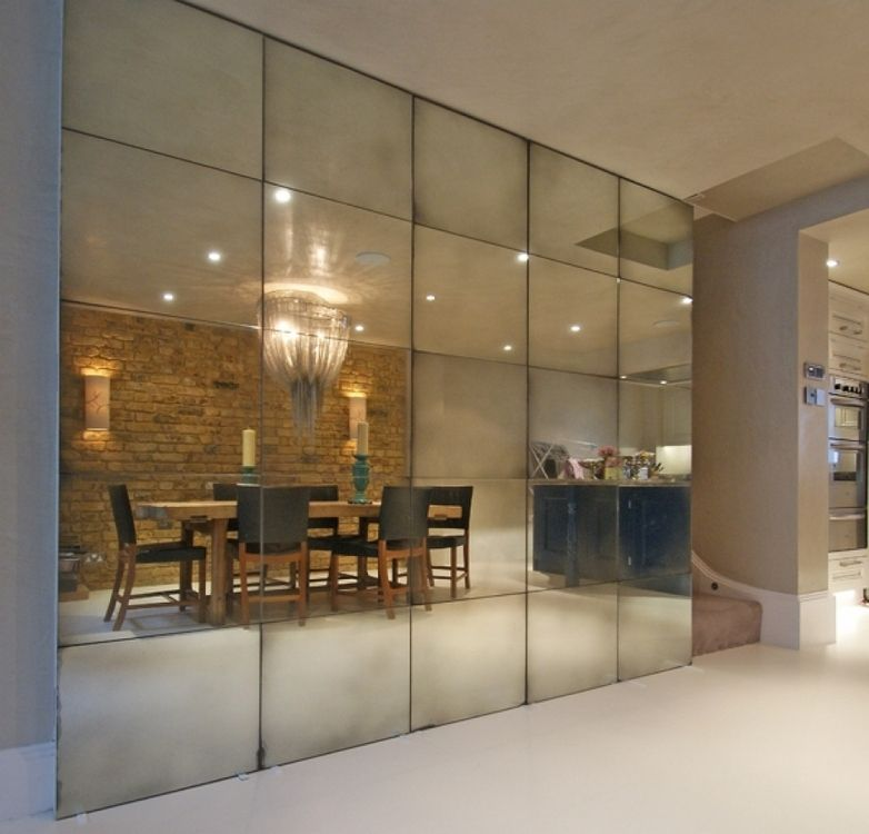 Medium Antique Mirrored Wall Concealing Folding Doors For