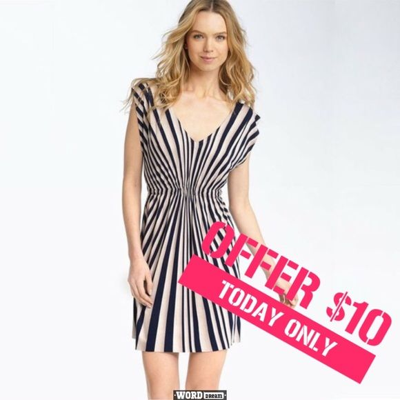 Nordstrom dress by Remain Size medium. Greenish grey stripe pattern. Flattering on your figure. Tags were uncomfortable so they were removed. Purchased at Nordstrom. I used this dress as a beach cover up. Model shot is the same dress in different colors. Nordstrom Swim Coverups