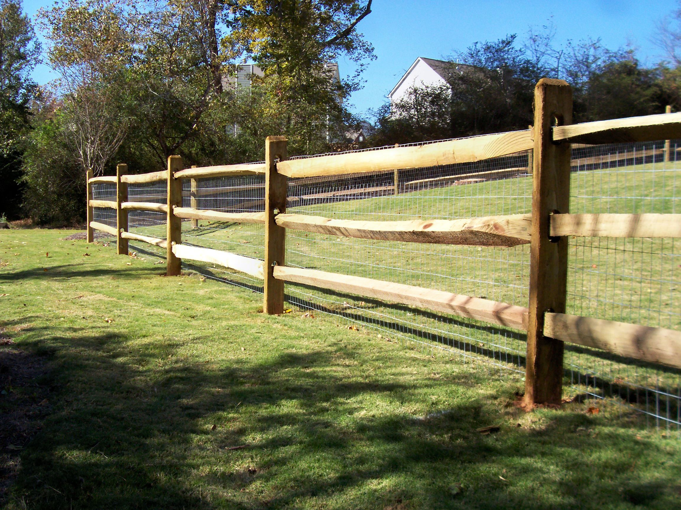Ranch style wood fence designs wood ranch rail fence for Simple fence plans