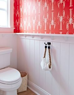 Rope Toilet Paper Holder Idea... http://www.completely-coastal.com/2016/11/beach-cottage-with-crisp-nautical.html Just use a rope curtain tie back!!