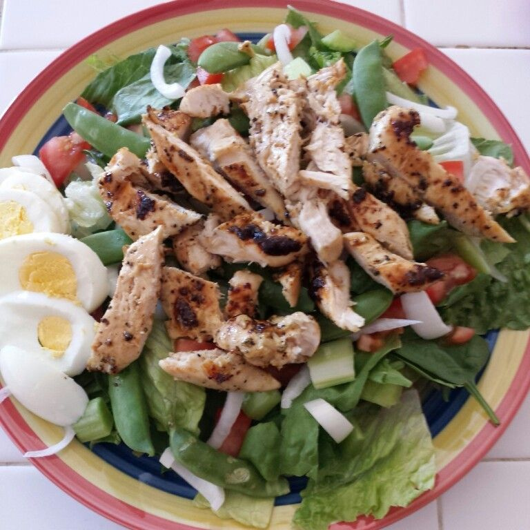 Grilled chicken salad with a hard boiled egg, sugar snap peas, celery, onion and tomatoes DASHdiet