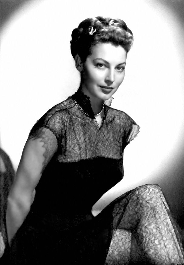 Ava Gardner...how times have changed and fashion stays the same. i think i have the same tights/stockings that she is wearing : )