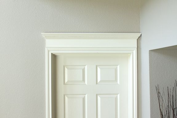 Crown molding above door home shit pinterest for Over door decorative molding