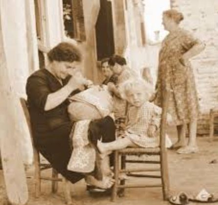 Vintage..~ making lace. cute little tyke with mom