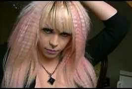 With An 80s Crimped Hair Style Pink Highlights