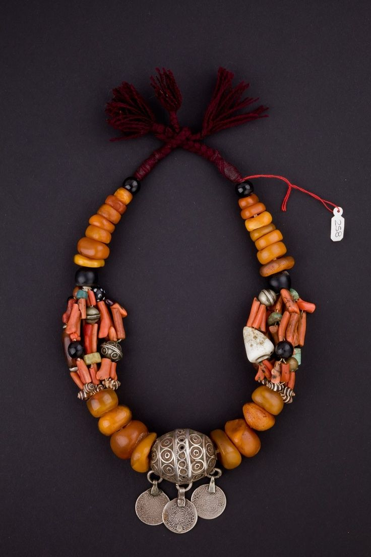 Morocco   Early 1900s Berber necklace. Amber, coral, shells, glass beads, silver and enamel.