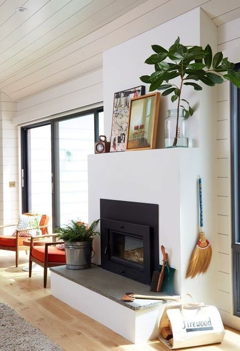 Shiplap walls, light hardwood floors, casual fireplace styling and ...