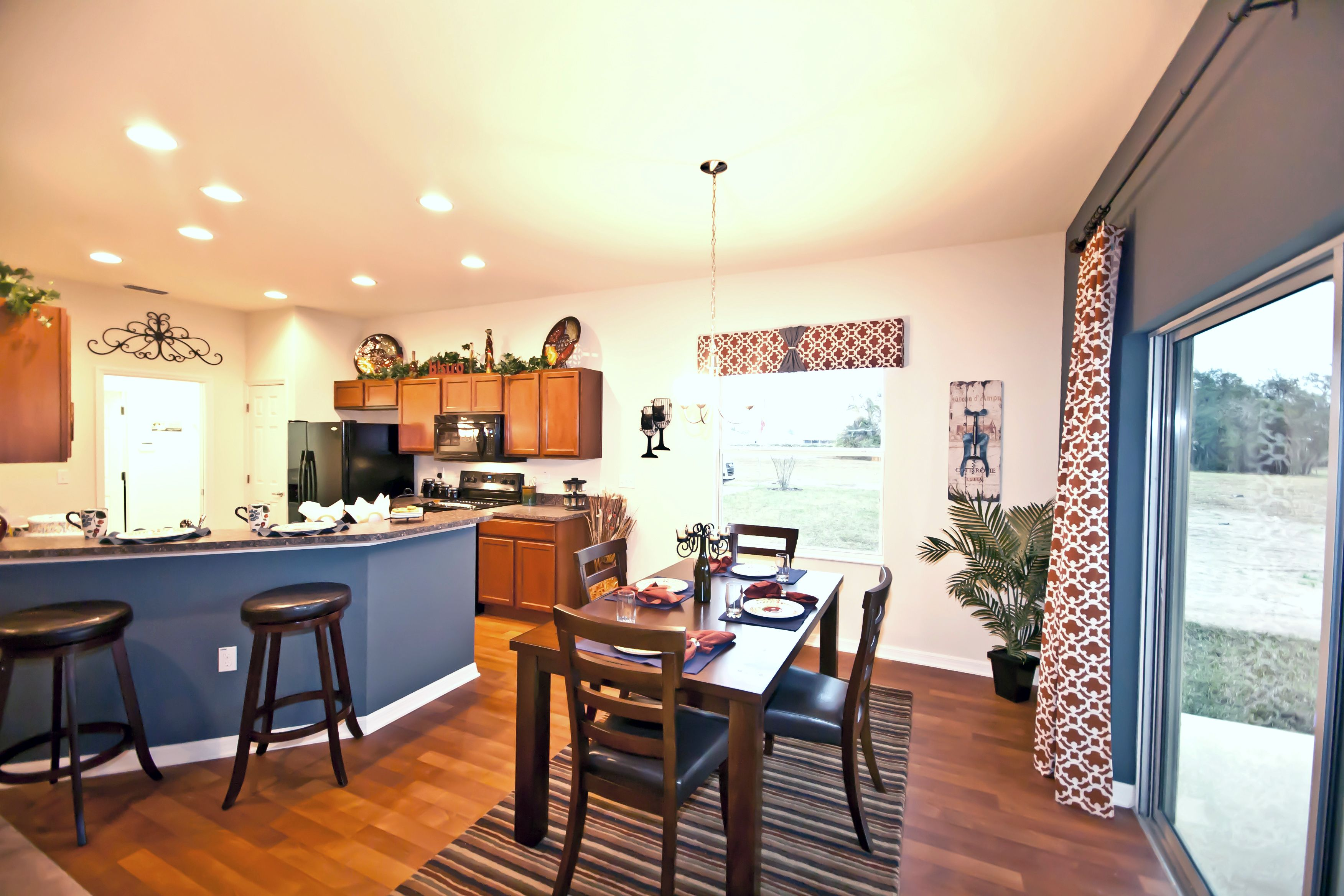 Love The Matching Accent Wall And Painted Under Breakfast Bar Highland Homes Model Home In Gibsonton Fl Decorating Decor Paint