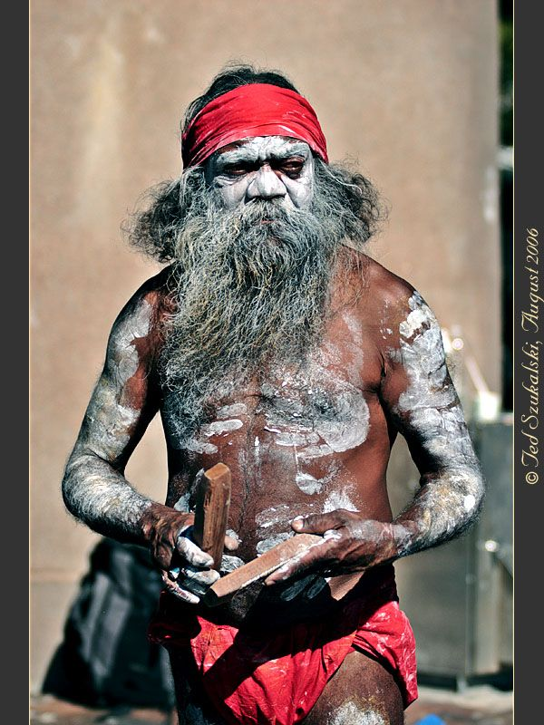 Aboriginal Elder and Cedric Playing Sticks - Australia