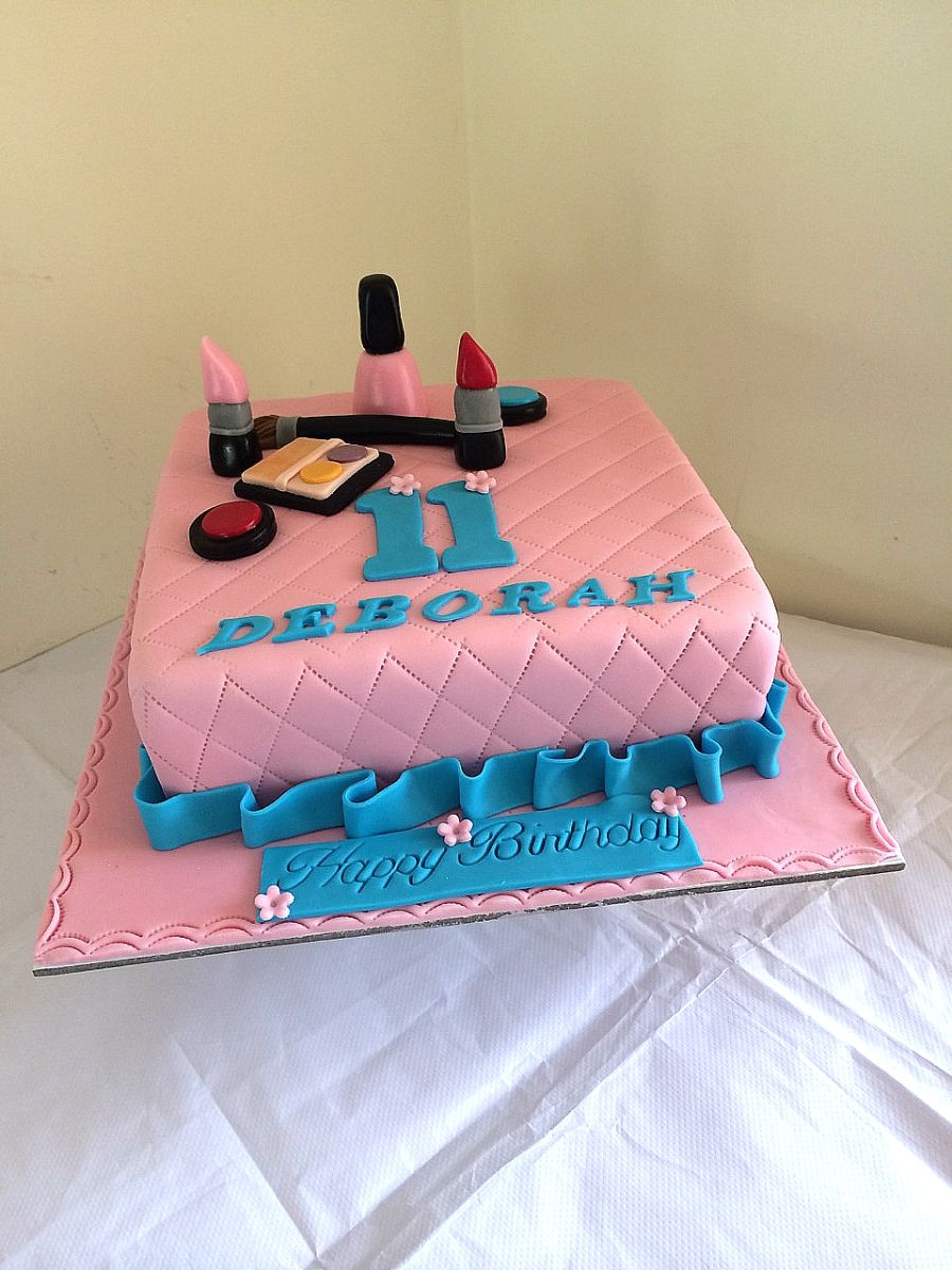 Pink and blue birthday cake for girls or teen girls with makeups