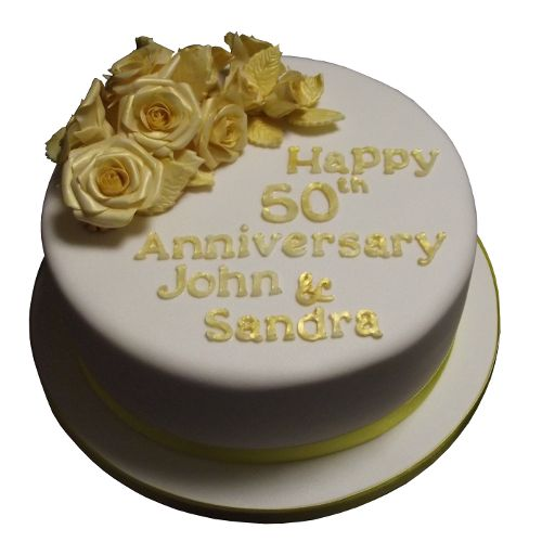 bGolden Wedding Anniversary CakebbrA spray of golden roses is