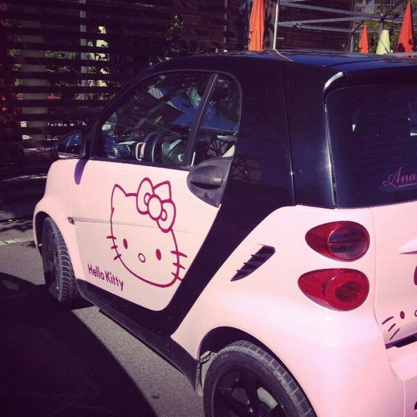 Hello Kitty, pink and small cars