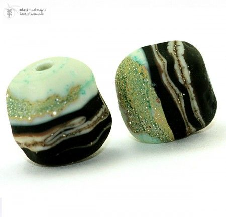 I really like the dramatic contrast between the pastel sea foam color and the black... with specks of silver. #lampwork #beads