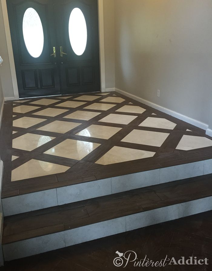 "Beautiful entry way with 18"" marble tile and 6 x 24"" wood look tiles. Stunning without breaking the bank."