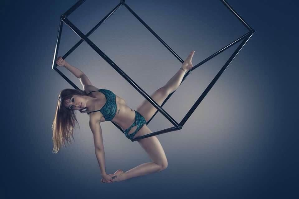 Aerial Cube side hang posing.