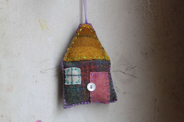 little wool house with golden roof by roses, via Flickr
