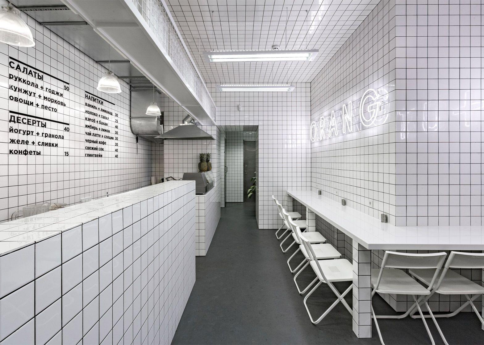 Orang utan veggie cafe has white tiling and neon signage ○ re