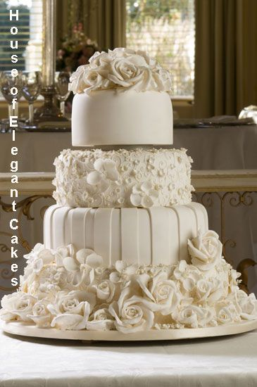 Beautiful cake. I love the difference of all the tiers.  The ribbon on the top tier is a nice touch of colour.   ᘡղbᘠ