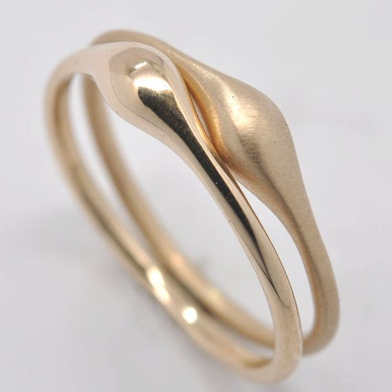 Wave stacking ring 18k gold by Onestonenewyork on Etsy//the finish! I'm in love.