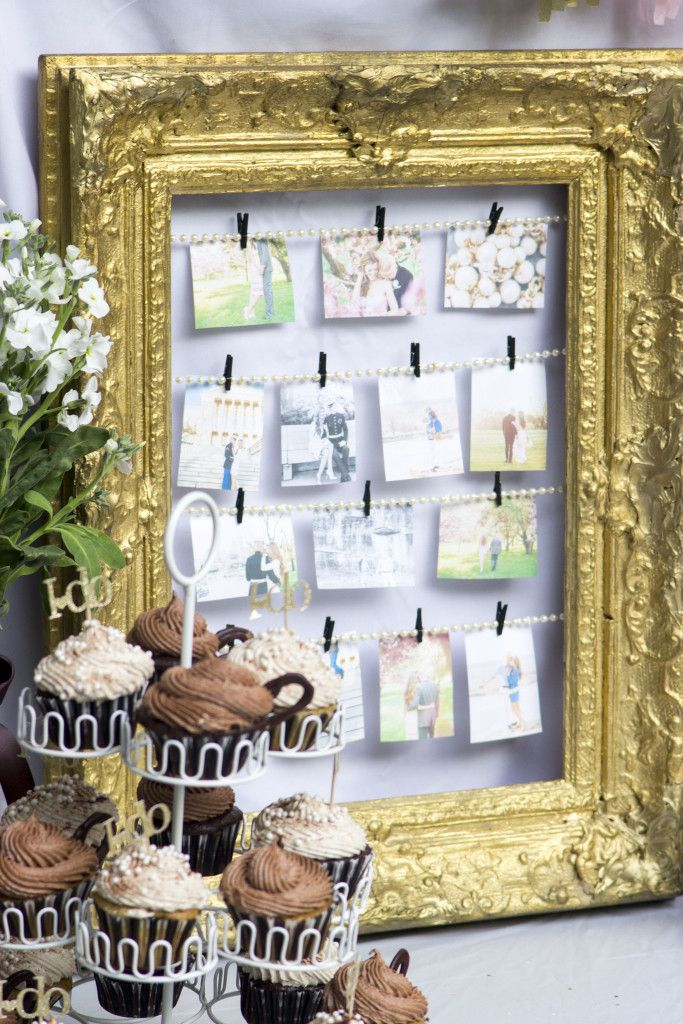 take a vintage frame string pearls and hang engagement pictures at your bridal shower